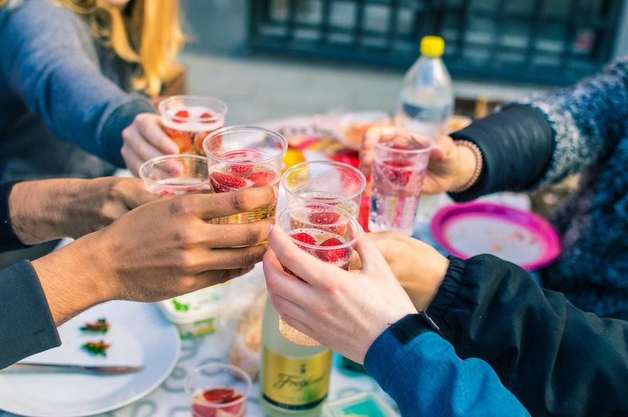 people sharing drinks outside cocktails and mocktails